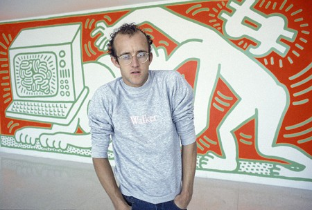 Keith Haring in front of his mural, Walker Art Center, 1984
