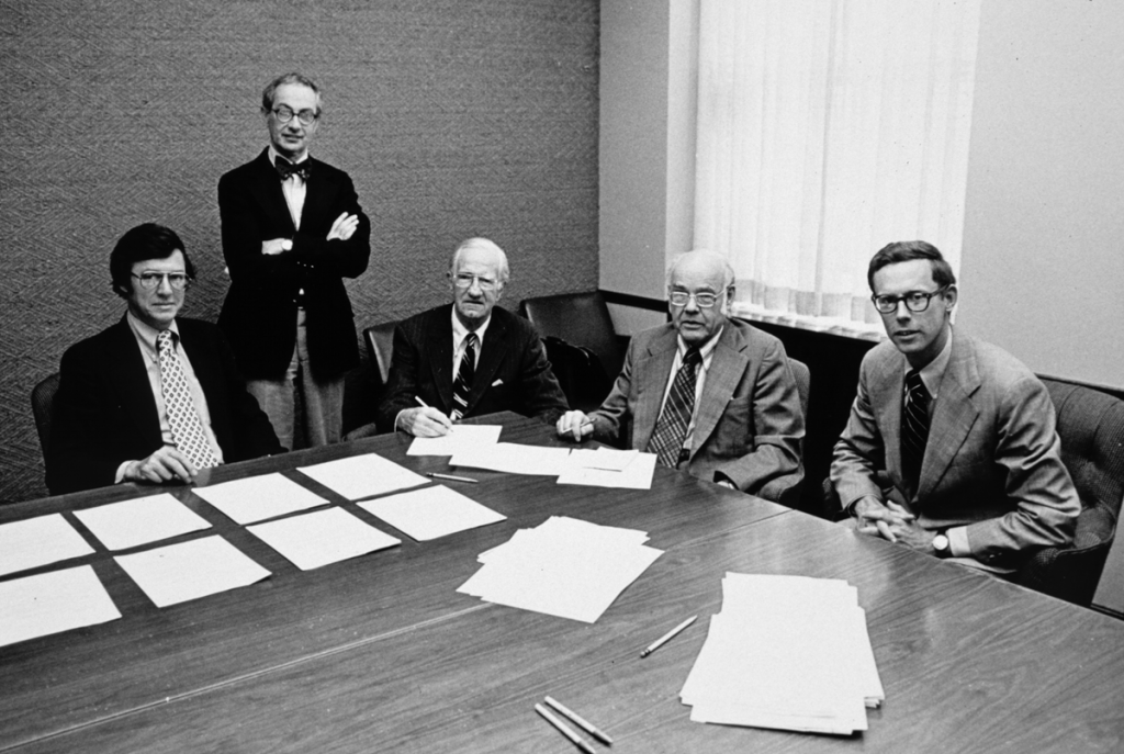 Roger Hale (currently an Honorary Trustee), Martin Friedman (currently Director Emeritus), Justin V. Smith (a Walker family member and former president of the T.B. Walker Foundation), Walter Walker (a Walker family member and the late husband to current board member Elaine), and Tom Crosby, with paperwork making the Walker a truly public institution, 1976. Photo: Walker Art Center Archives