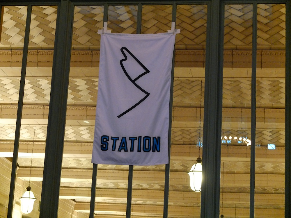 Lawrence Weiner designed flags for each of Station to Station's stops. Here's what he came up with for St. Paul.