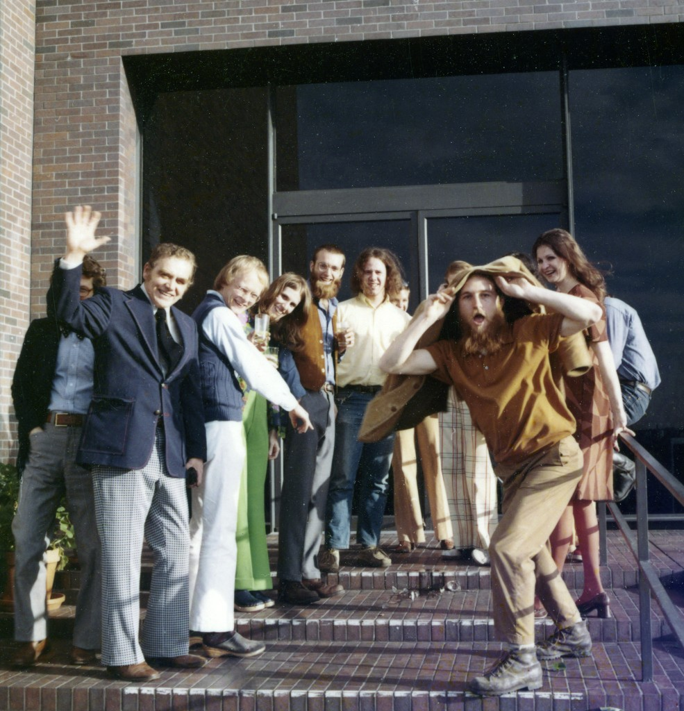 Circa 1976 staff gathering on terrace, Eric Sutherland far left.