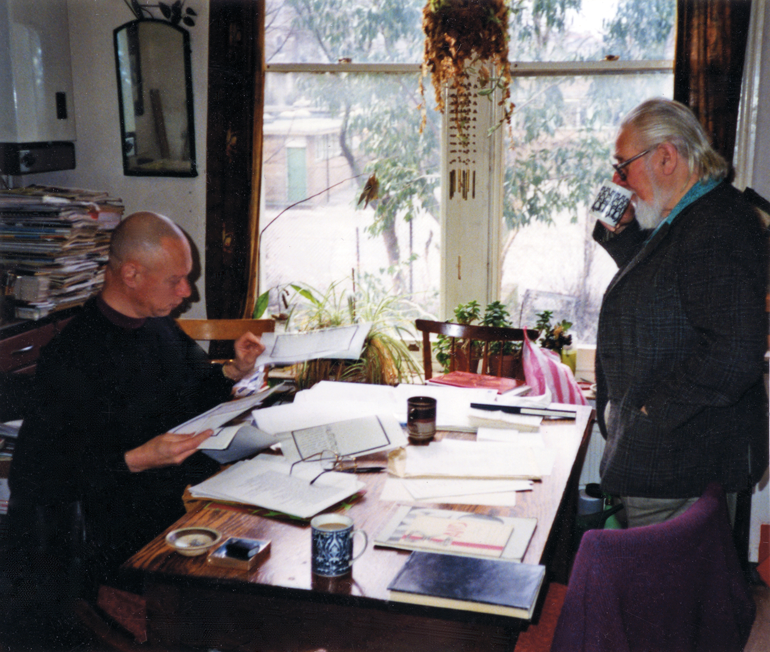 Adrian Clarke and Bob Cobbing in the kitchen of Cobbing and Pike's home at Petherton Road editing AND 9, 1995. Photographer: Jennifer Pike.