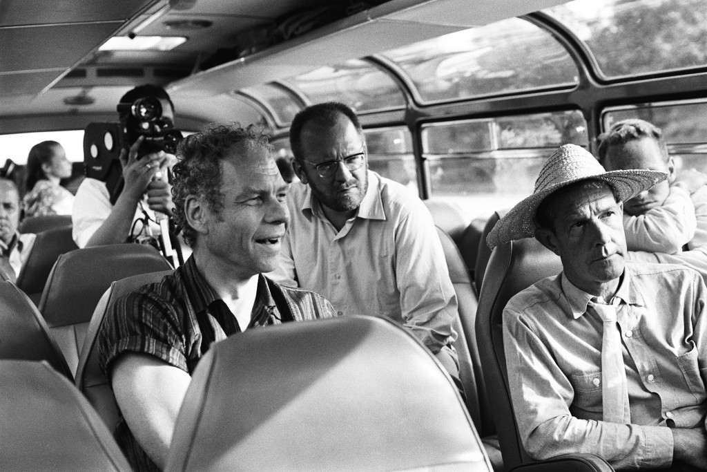 "On a cach from Paris to Hamburg for the shooting of Cunningham's Ballet""Variations V"", Merce Cunningham, movie maker Klaus Wildenham, John Cage(straw hat), 1966."