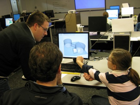 Adam Jarvi leading a family through the 3D modeling process
