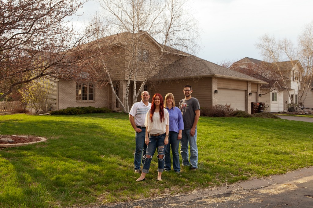 The Schoenherr family--X, Y, Z, and A--in front of the Woodbury lawn that'll be transformed into a vegetable garden. Photo: Gene Pittman