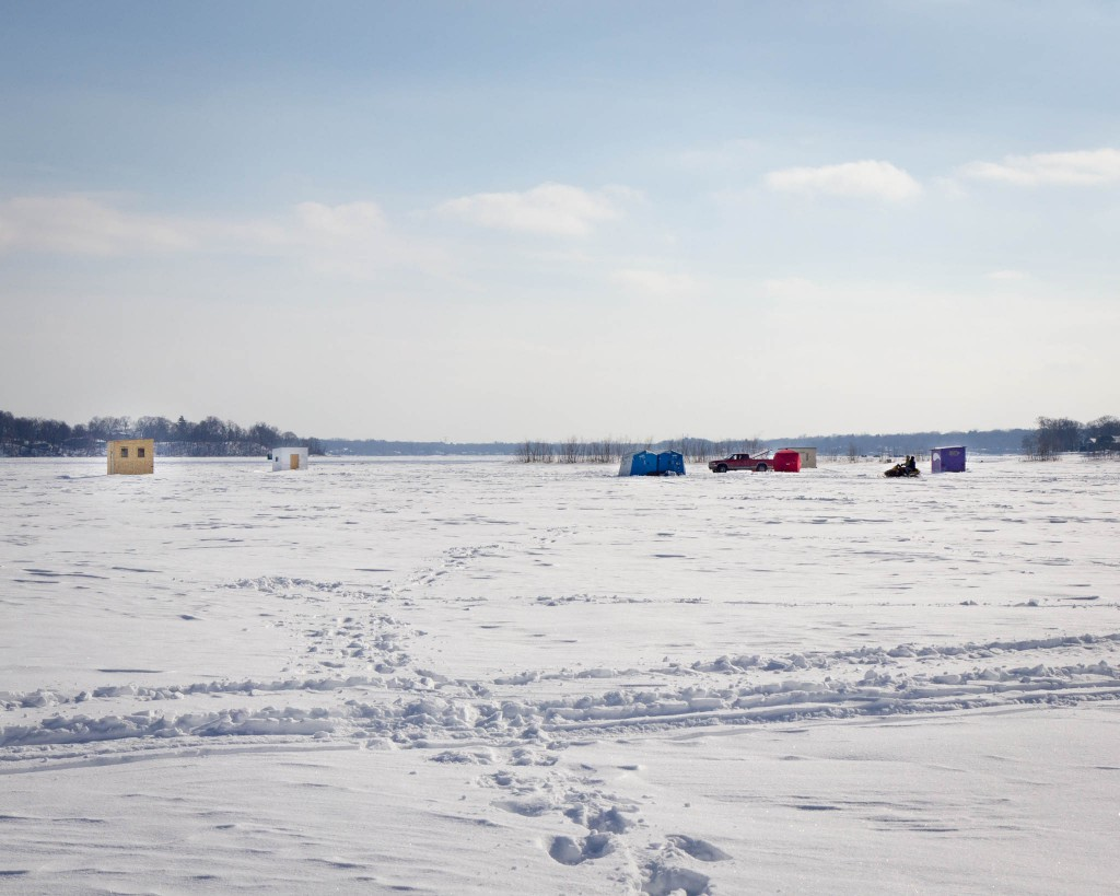 A nearby cluster of icefishing shacks