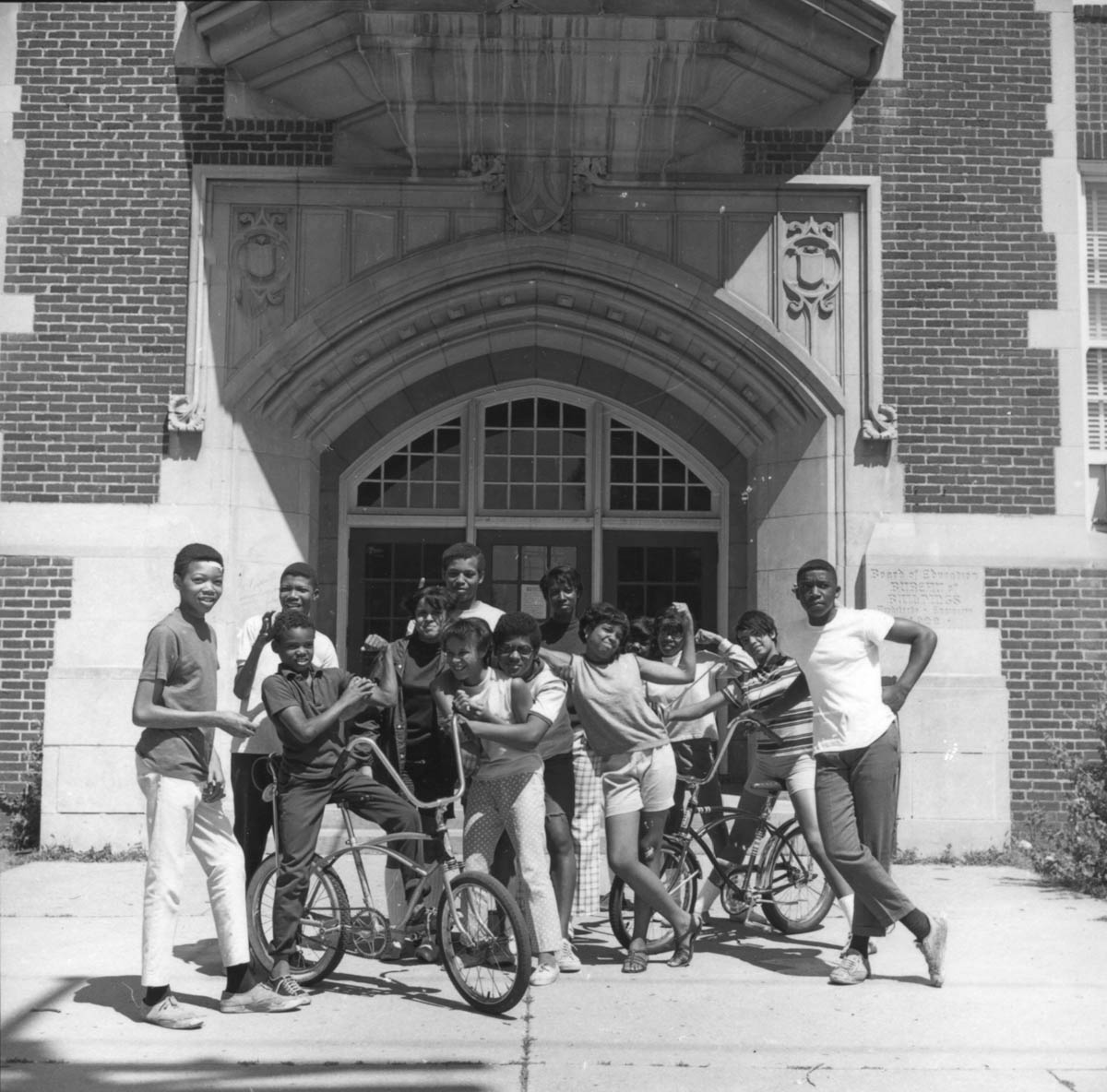 Kids (some of them workshop students [?]) in front of Bryant Junior High School, 1968