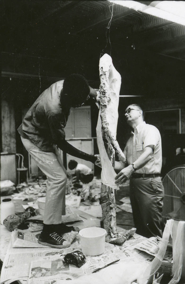 Ron Williams (on table) works on his <i>Mylar Figure</i> while Howard Thill advises, 1968