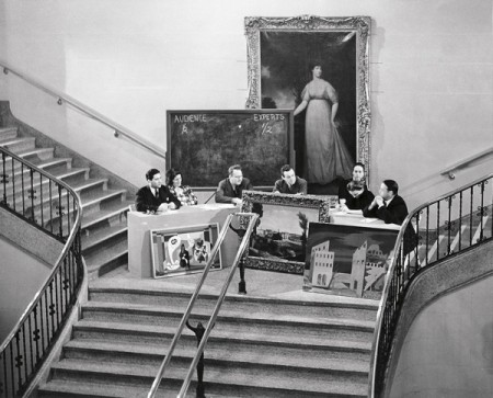 "Daniel Defenbacher (center) quizzes panelists during an ""inquisition,"" Walker Art Center atrium, 1940"