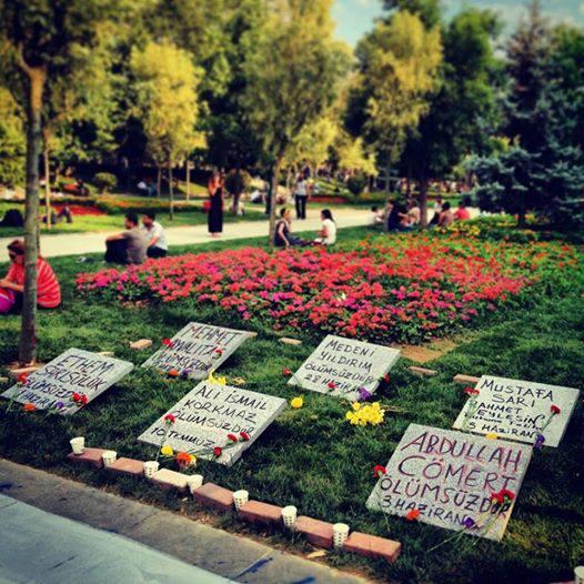 Gravestones in Gezi Park in memory of Medeni Yıldırım, Ali İsmail Korkmaz, Mehmet Ayvalıtaş, Abdullah Cömert, Ethem Sarısülük and police officer Mustafa Sarı. Found image.