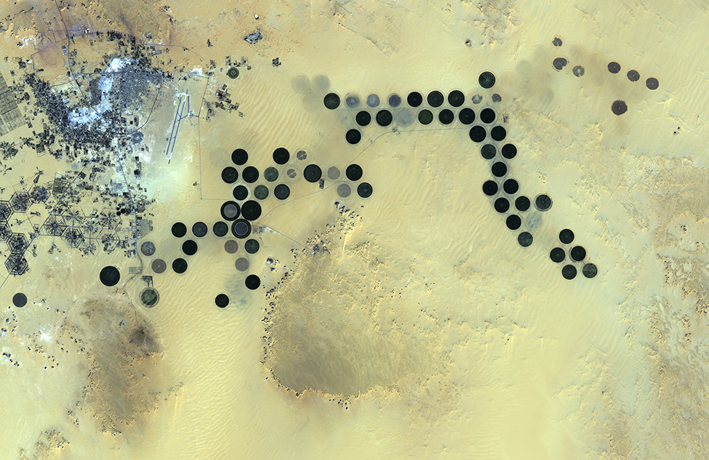 Circular irrigated agricultural plots near the the Al Jawf oasis in Libya, as seen from Japan's ALOS satellite. Image: European Space Agency