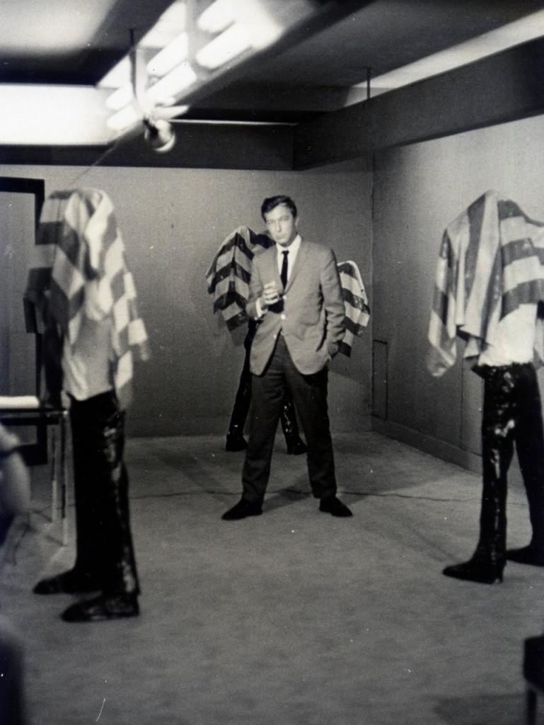 Jasper Johns posing with Kojima Nobuaki's Standing Figures, Tokyo, 1964 Photograph by Jun'ichi Takeishi; courtesy Tsubouchi Kazutada