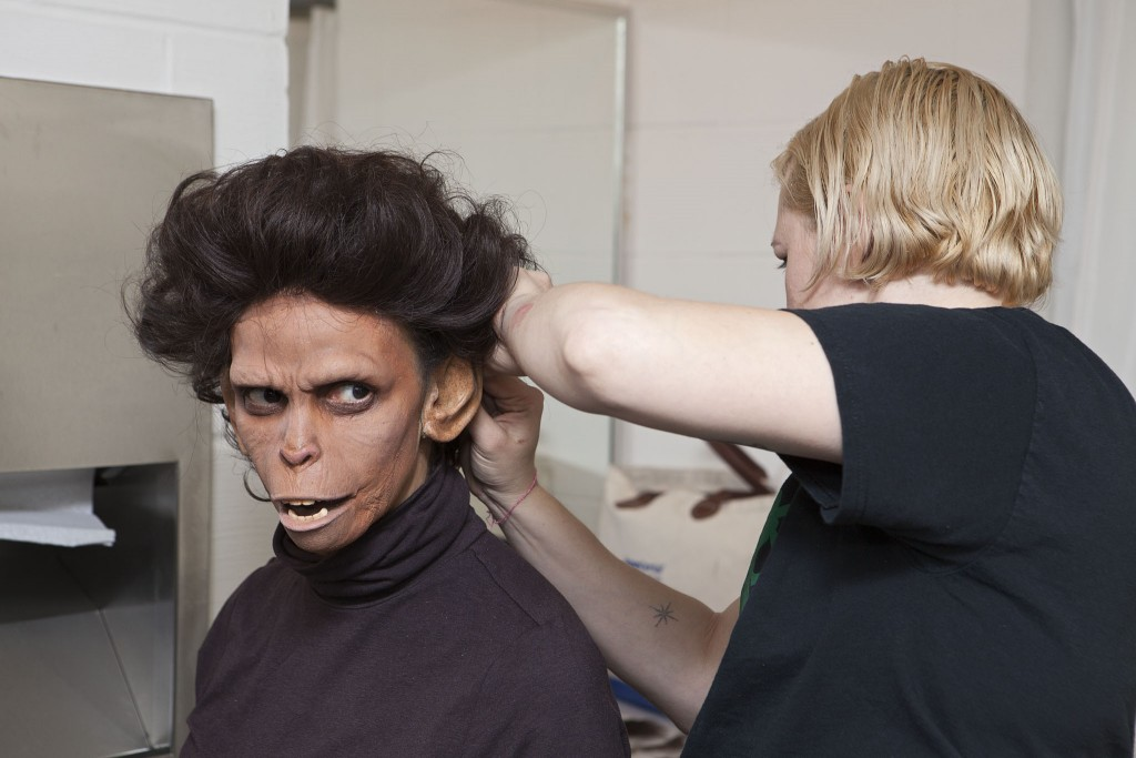 pa2014rp_Dr.Zira-makeup Visual Arts; Performing Arts. Artist Coco Fusco becoming Dr. Zira for her performance of: Observations of Predation in Humans: A lecture by Dr. Zira, Animal Psychologist. November 6, 2014, Walker Cinema. Part of Radical Presence: Black Performance in Contemporary Art, Target and Friedman Galleries, July 24, 2014 - January 4, 2015. Join artist Coco Fusco for her performance of Observations of Predation in Humans: A lecture by Dr. Zira, Animal Psychologist. Fusco will personify Dr. Zira—a chimpanzee psychologist who studies human behavior in the 1968 movie Planet of the Apes—taking a look at economic violence from an evolutionary perspective.