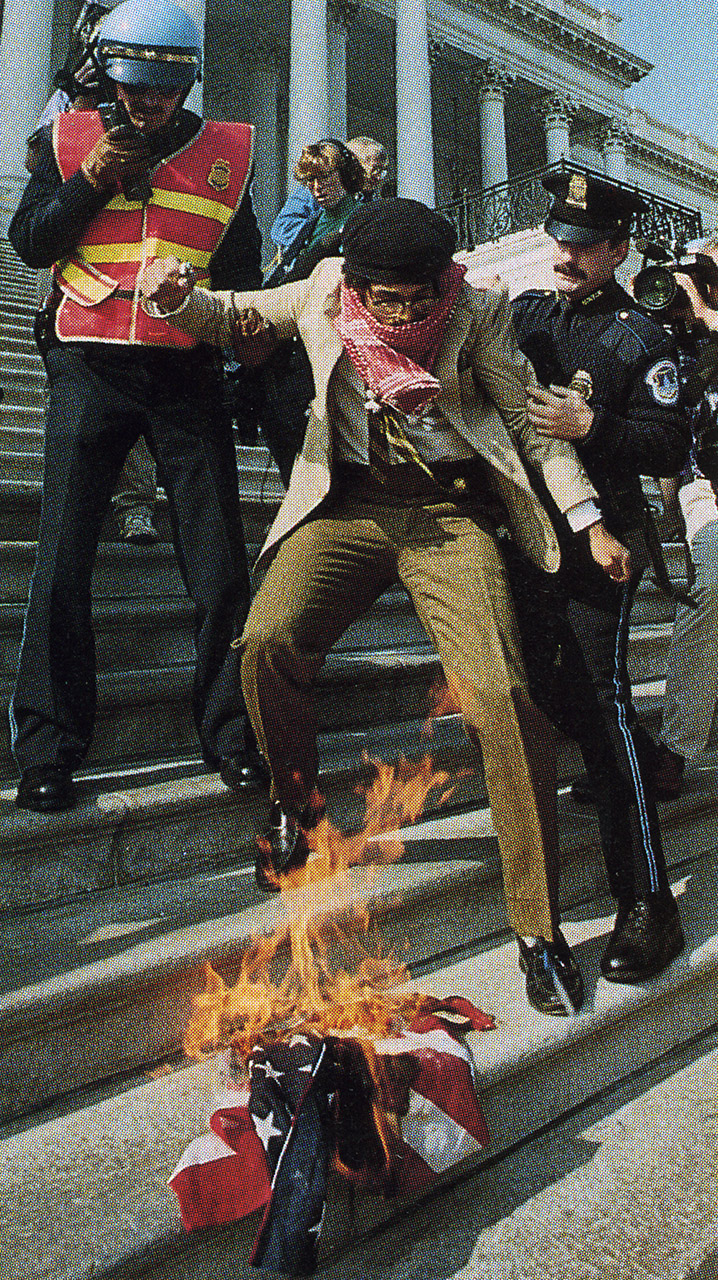 Dread Scott burning a flag on the steps of the US Capitol, 1989. Courtesy the artist