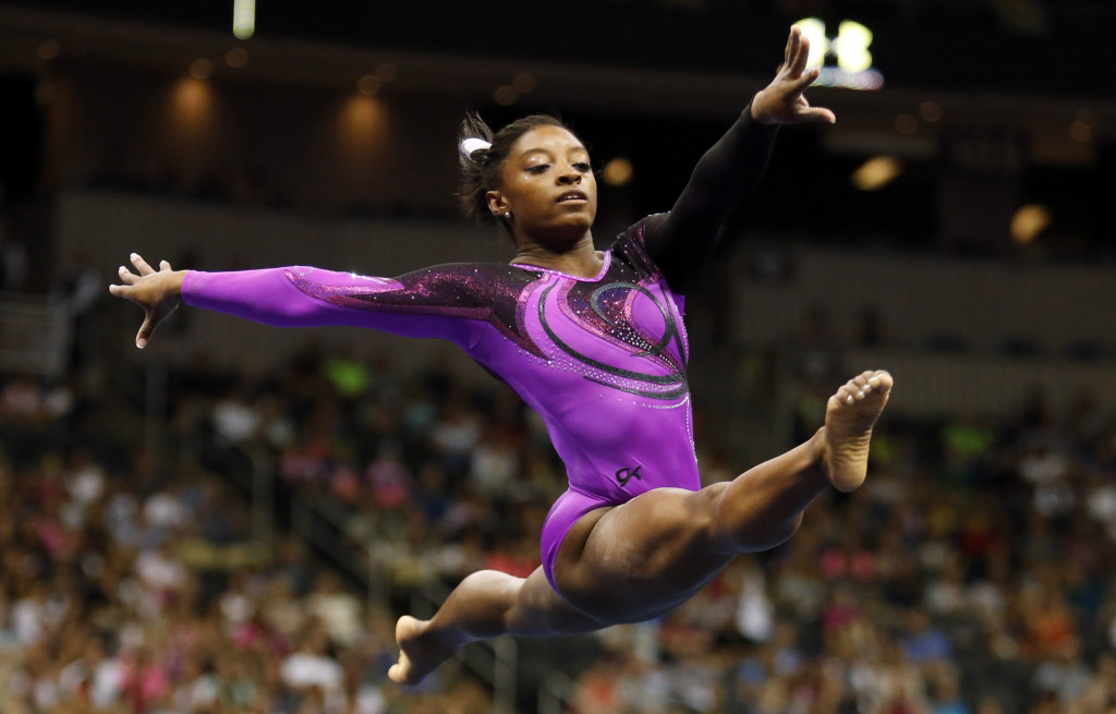 Aug 23, 2014; Pittsburgh, PA, USA; Simone Biles competes on the floor exercise portion at the 2014 P&G Championships at the CONSOL Energy Center. Mandatory Credit: Charles LeClaire-USA TODAY Sports