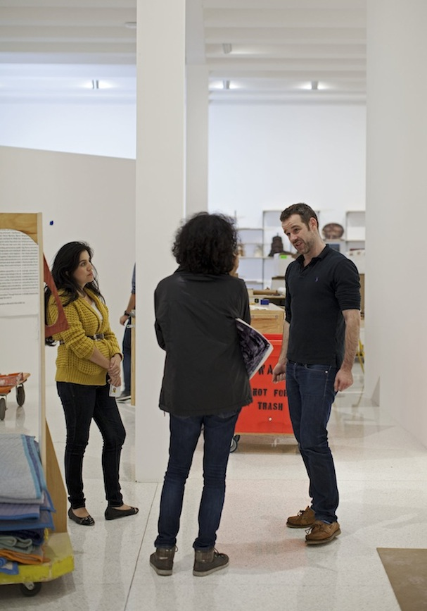 Natascha Sadr Haghighian (center) discussing her installation with Curator Bartholomew Ryan and Curatorial Fellow Mia Lopez. Photo: Gene Pittman