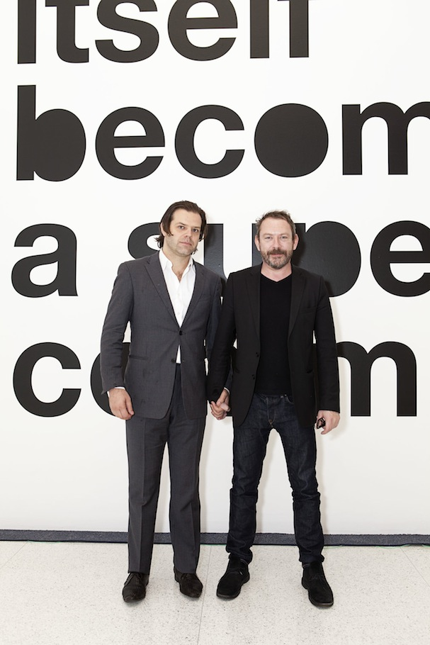 Renzo Martens and Liam Gillick in front of a part of Gillick's installation