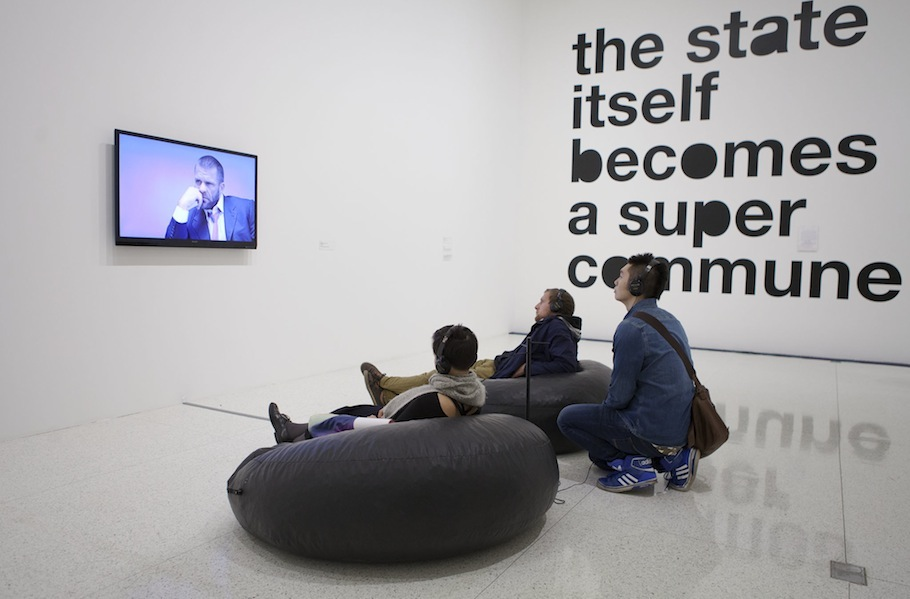 Attendees sit and watch Bjarne Melgaard's _Untitled_ (Bjarne Melgaard interviews Leo Bersani) (2011)