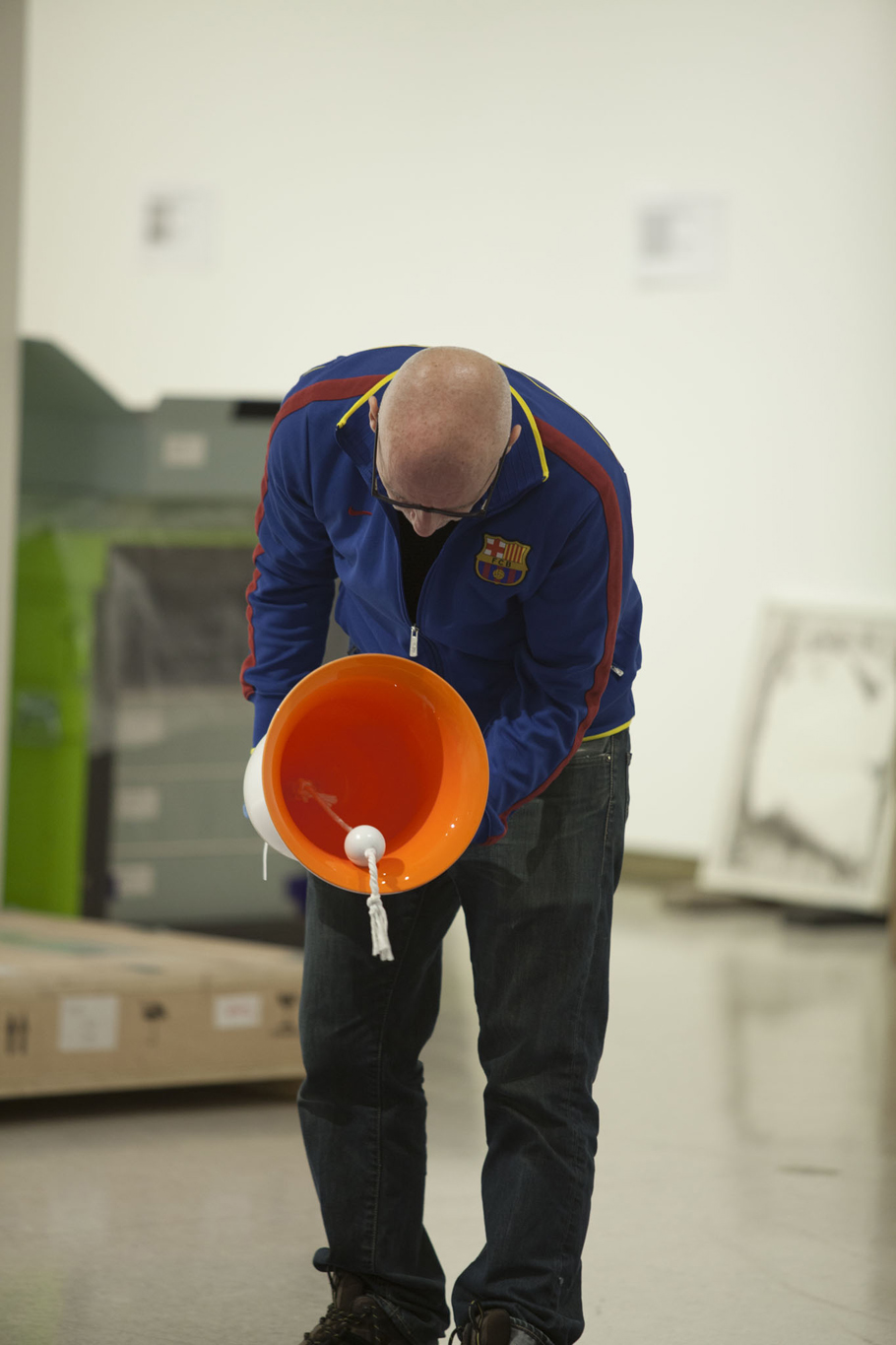 Hodges inspecting one of the blown glass bells that make up Untitled (bells), 2002.