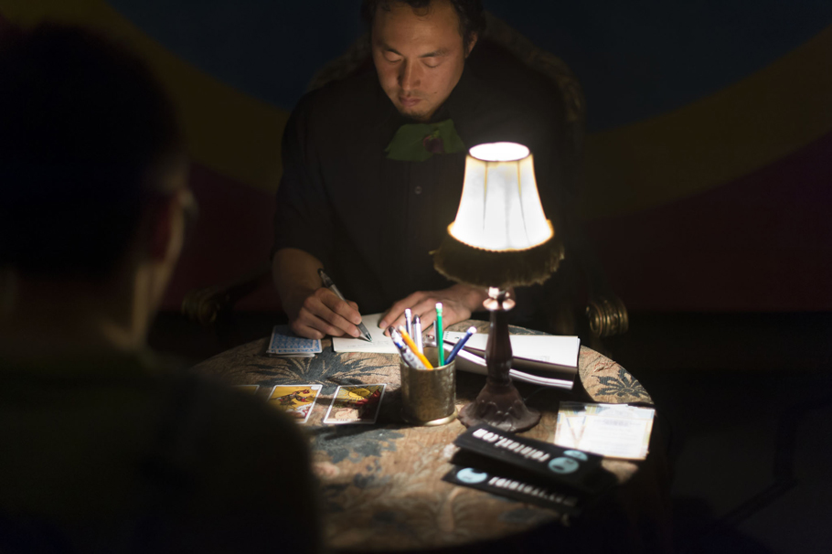 Ed Bok Lee reading tarot cards for Poetry Tarot