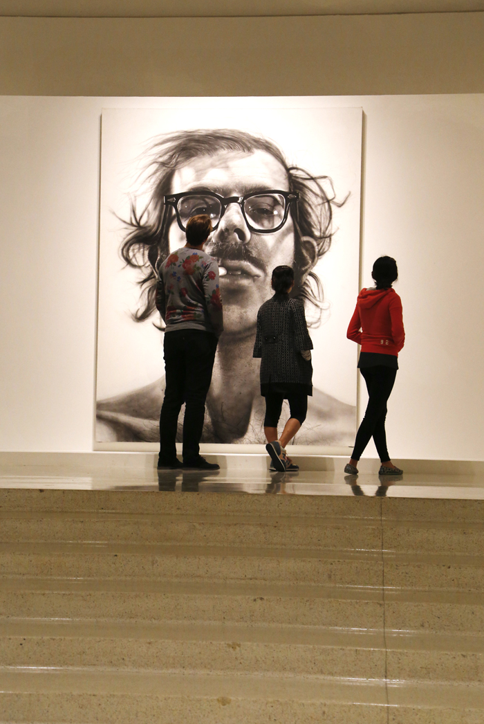 Visitors take in Chuck Close Big Self Portrait